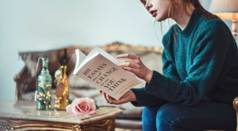 Girl reading a book on essays