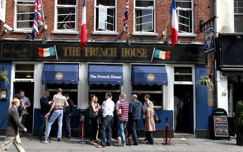 People outside The French House pub in Soho